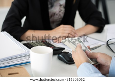 Man offering batch of hundred dollar bills. Hands close up. Venality, bribe, corruption concept - stock photo