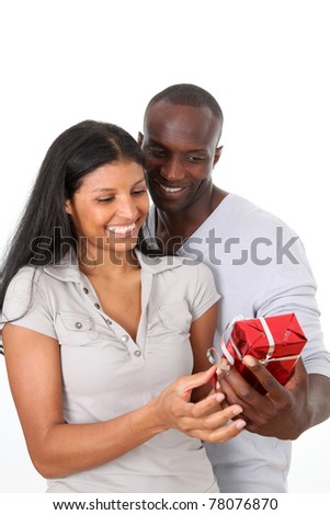 Man offering gift to woman on her birthday