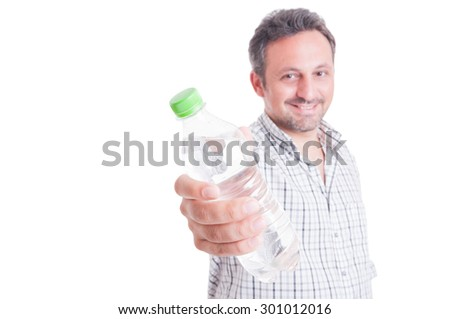 Man offering, giving a bottle of cold water as hydration concept in summer heat or heatwave - stock photo