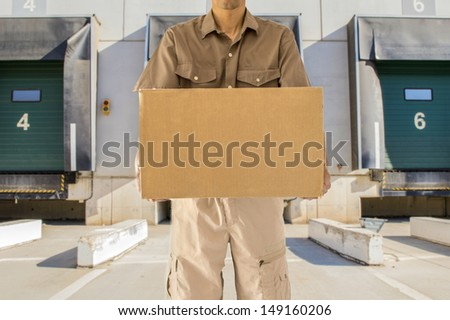 Man offering his goods transportation service from loading bay for trucks  - stock photo