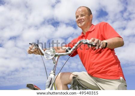 Man on a bike - stock photo
