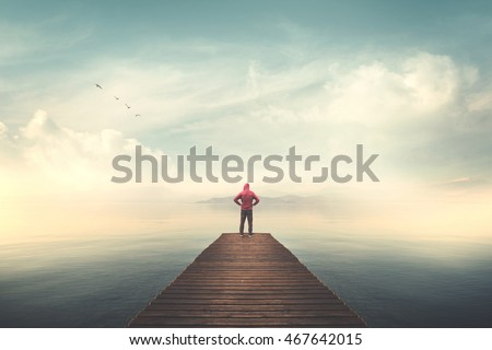 Man on a boardwalk looking at beautiful view on sea