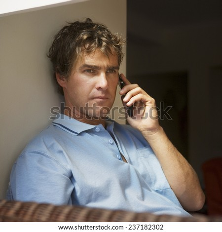 Man on a Cell Phone - stock photo