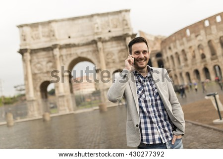 Man on a phone at the street in Rome, Italy - stock photo