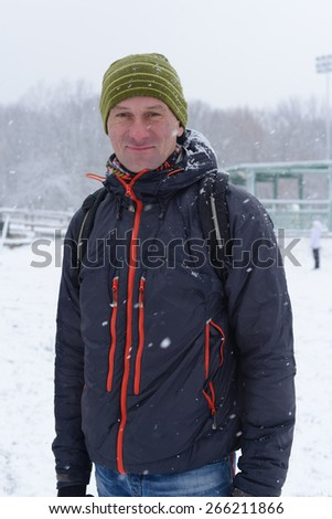 Man on a snow-covered slope - stock photo