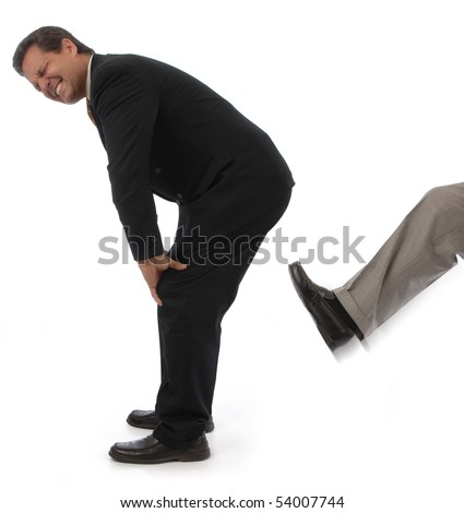 Man on a white background getting kicked in the behind - stock photo