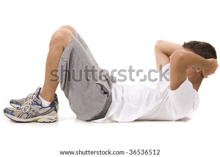 Man on a white background in a fitness pose. - stock photo