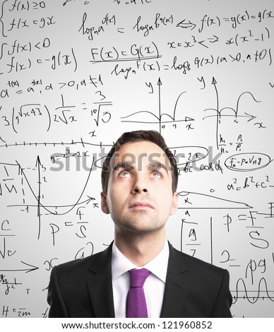 man on background of board with formulas