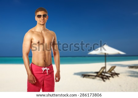 Man on beach at Maldives, South Male Atoll. Collage. - stock photo