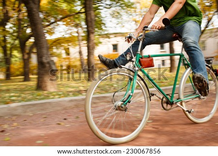 Man on bike - stock photo