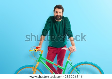 man on bike over colorful background - stock photo