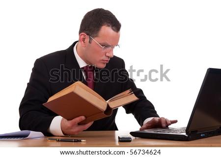 man on desk reading and studying, isolated on white background, studio shot. - stock photo
