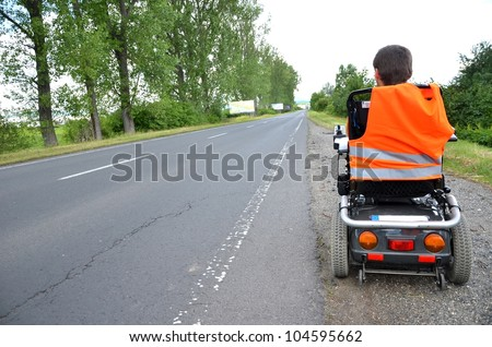 man on Electric Wheelchair - stock photo