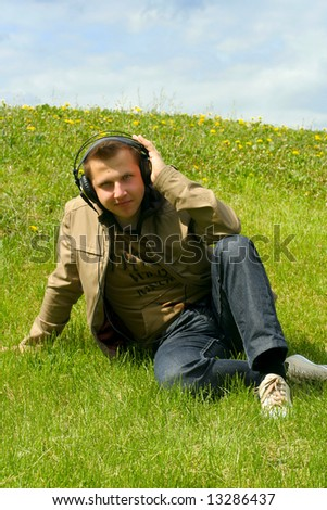 Man on green grass - stock photo