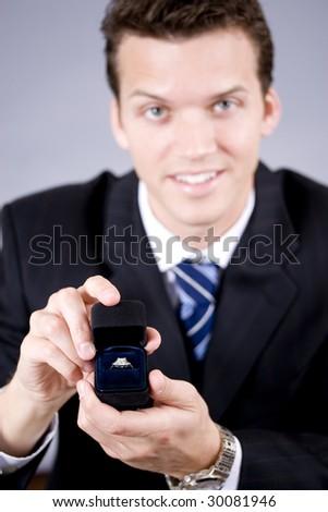 Man on his knees proposing - stock photo