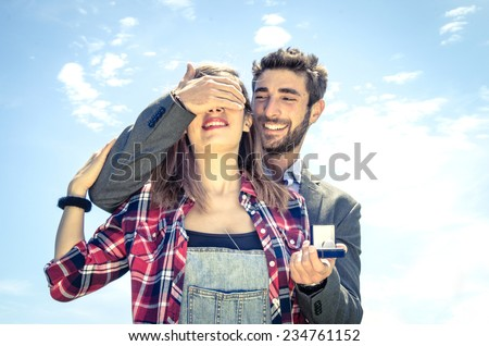 Man on knee giving to his girlfriend a ring - wedding proposal - stock photo