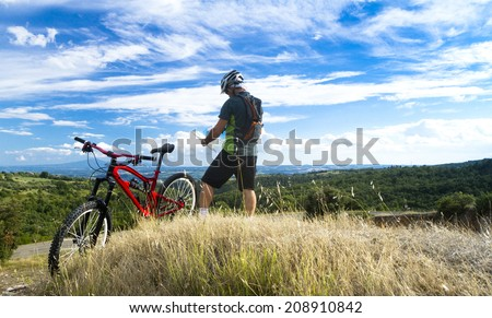 man on mountain bike read the map