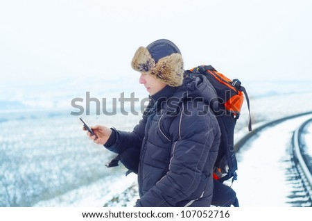 Man on railroad - stock photo