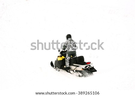 Man on snowmobile. Winter sports and entertainment.
