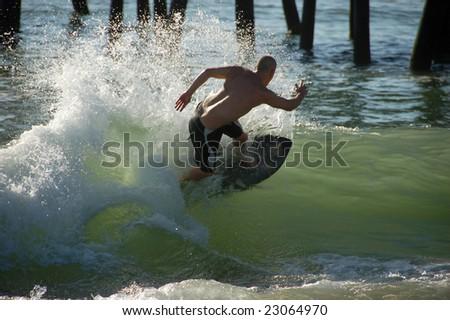 Man on surf board - stock photo