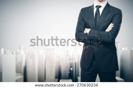 Man on the background of the modern city project - stock photo