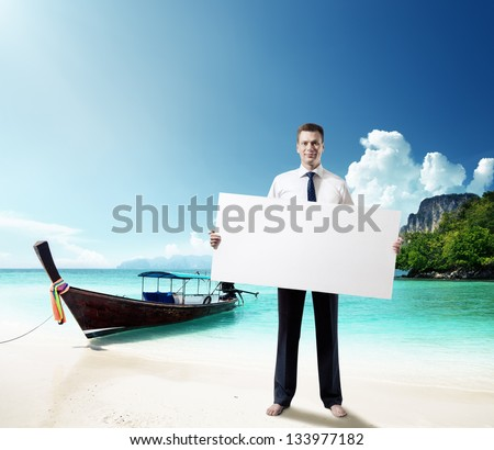 man on the beach of Thailand with empty board in hand - stock photo