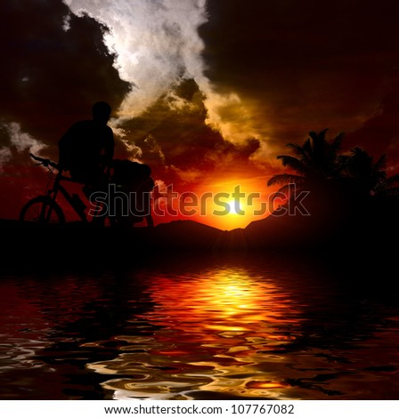 man on the bicycle at sunset