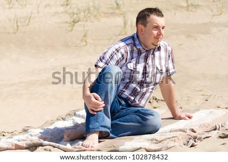 Man on the irish beach - stock photo