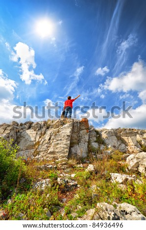 man on the mountain top. conqueror of the height