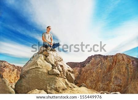 man on the peak of mountain - stock photo