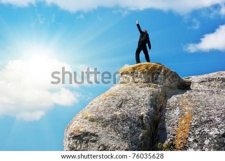 Man on the peak of mountain. - stock photo
