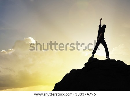 Man on the peak of mountain and sunlight , success,winner, leader growth vision leadership  healthy on nature sky and cloud imagination sport outdoor relax business friendship relationship concept - stock photo