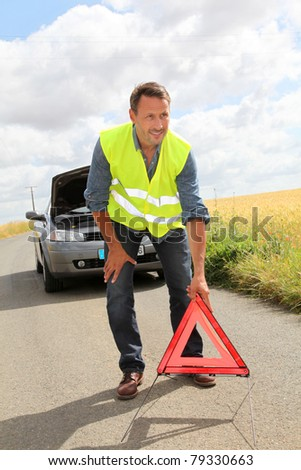 Man on the road with car breakdown waiting for rescue - stock photo