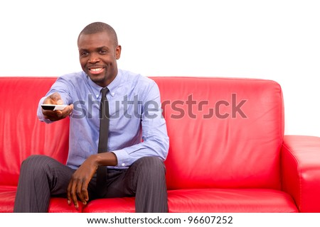 man on the sofa with remote control - stock photo