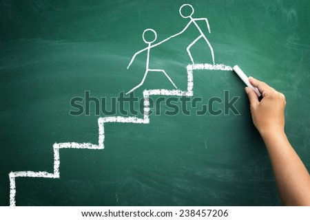man on the top of a stairs helping an other man to climb it, sketch people on chalkboard, concept hand help - stock photo