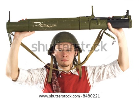 Man on the white background with rocketlauncher. Low depth of field, focus point on the face. - stock photo