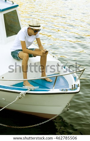 man on the yacht in summer at sunset