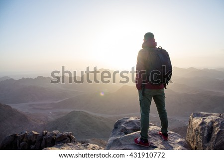 man on top of a mountain in the Sinai mountains in Egypt