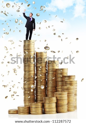 man on top of euro coin piles - stock photo