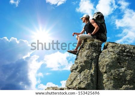Man on top of mountain. - stock photo