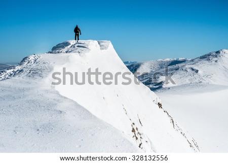 Man on top of mountain - stock photo