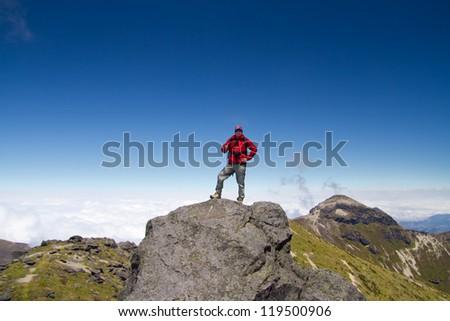 Man on top of mountain, andes mountains, pichincha volcano, Ecuador - stock photo