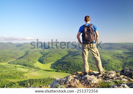 Man on top of mountain. Tourism concept  - stock photo