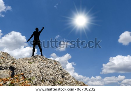 man on top of the mountain reaches for the moon