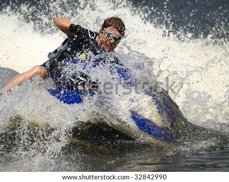Man on Wave Runner dives in the water - stock photo