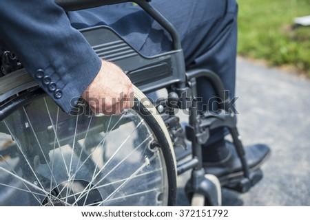 Man on wheelchair - stock photo