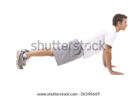 Man on white background doing push ups. - stock photo