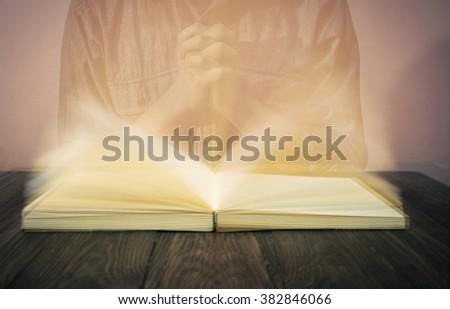 Man Opened Reading Bible  And Praying ,Blur (Vintage) - stock photo