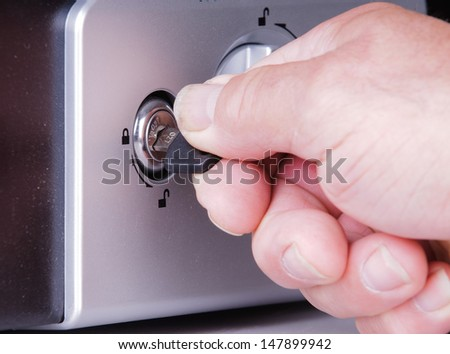 man opening a safe - stock photo
