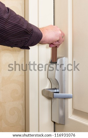 Man opening door with keyless entry card - stock photo